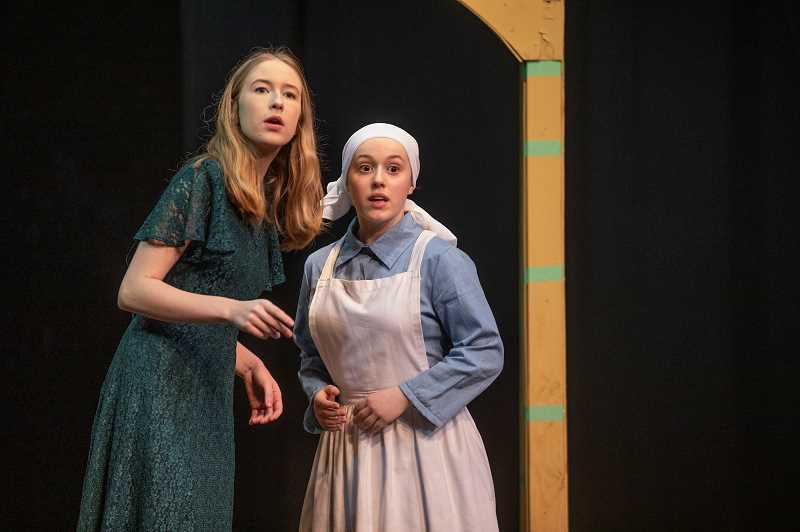 SPOKESMAN PHOTO: JONATHAN HOUSE - Averyl Hartje playing Beatrice, left, and Samantha Katz playing Hero, rehearse for the Wilsonville High performance of 'Much Ado About Nothing.'