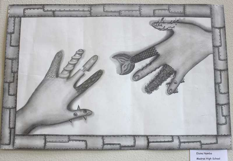 DESIREE BERGSTROM/MADRAS PIONEER - A 'Textured Hands' art piece, by Madras High School student Elaina Nambo, is on display at Art Adventure Gallery through the month of February.