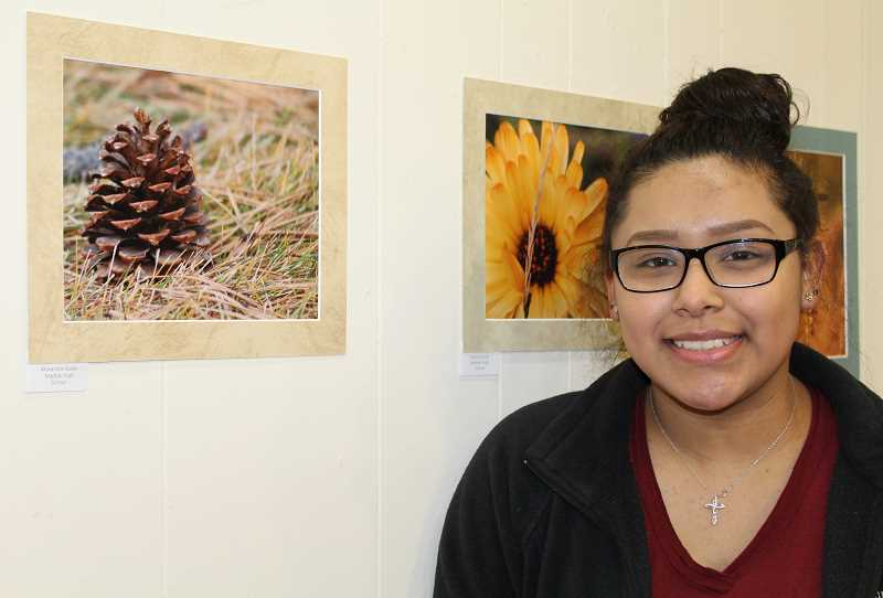 HOLLY M. GILL/MADRAS PIONEER - Alexandra Galan, 15, a sophomore at MHS, displays a creative photo of a pinecone she took for Sue Young's photography class.