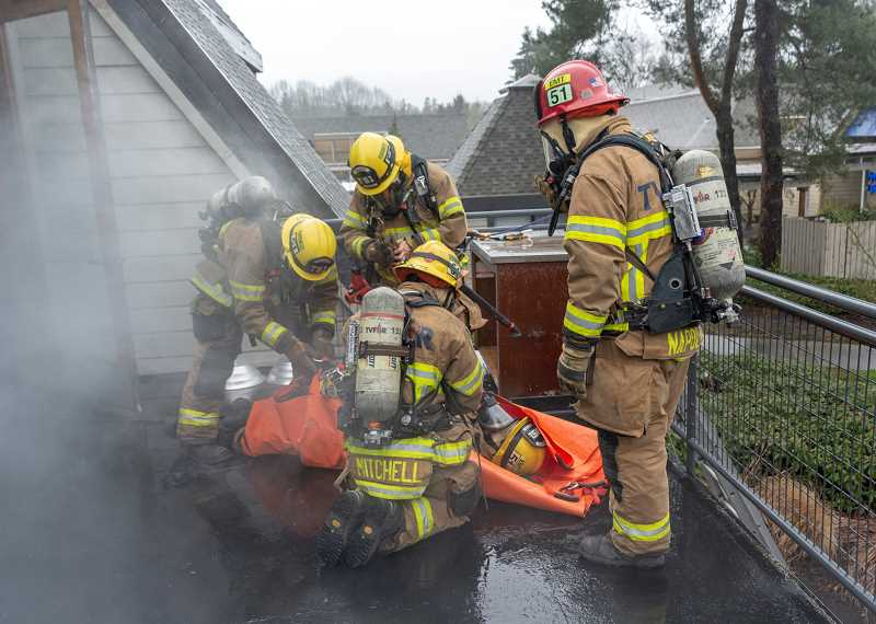 SUBMITTED PHOTOS: TUALATIN VALLEY FIRE & RESCUE - Tualatin Valley Fire & Rescue is practicing rescue scenarios at a building in Charbonneau three times this month.