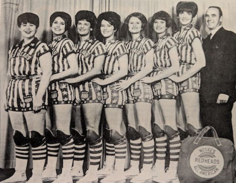 PMG ARCHIVE PHOTO - Moores All-American Red Heads, a world champion womens basketball team, took on Sandys mens basketball team in a one-time competition at Sandy High School 50 years ago.