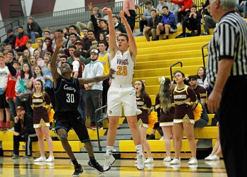 STAFF PHOTO: WADE EVANSON - Forest Grove's Adison Emerick takes a 3-point shot during the Vikings' game against Century Tuesday, Feb. 19, at Forest Grove High School.