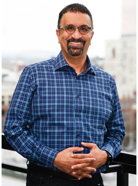 COURTESY: TIE OREGON - Nitin Rai, President of TiE Oregon and Chair of TiE Global, says when he met Parker at GlobeSherpa, 'I could tell from day one that he had what it takes to make a company a big success. He had a great idea, the intelligence, the passion, and the drive.'