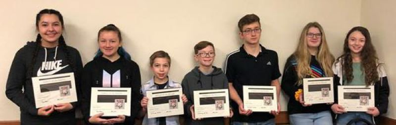 COURTESY: ST. HELENS SPORTS BOOSTER CLUB - St. Helens Middle School Athletes of the Month (from left): Ashley Hernandez (8th-grade girls basketball) , Ruby Nelson (8th-grade girls basketball), Michael Cobabe (6th-grade wrestling), Wyatt Dingman (7th-grade wrestling), Aden Oehlert (8th-grade wrestling), Caitlin Keefe (7th-grade girls basketball) and Maisy McDole (7th-grade girls basketball).