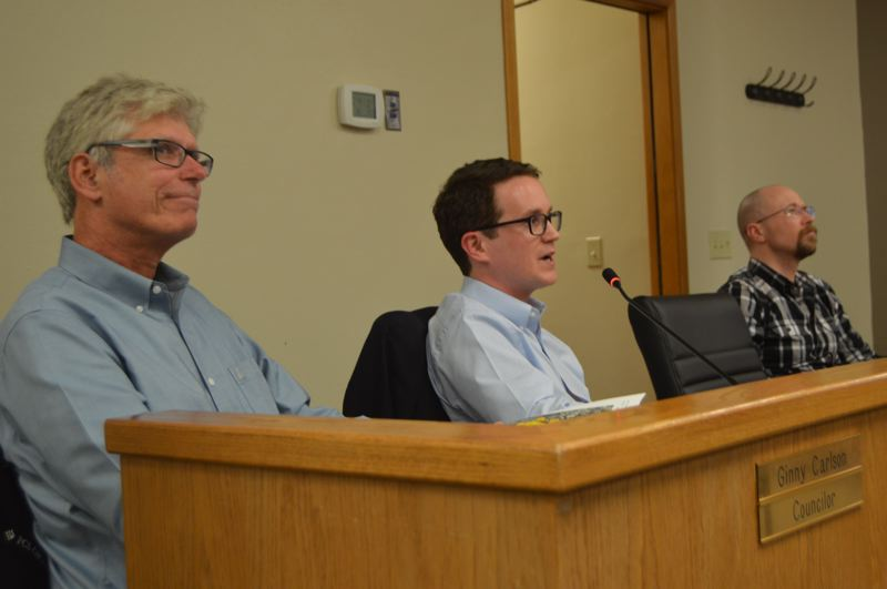 SPOTLIGHT PHOTO: NICOLE THILL-PACHECO - Todd Chase and Tim Wood, left and center, consultants with FCS Group, speak during a housing needs anaylsis public meeting on Tuesday, Feb. 12.