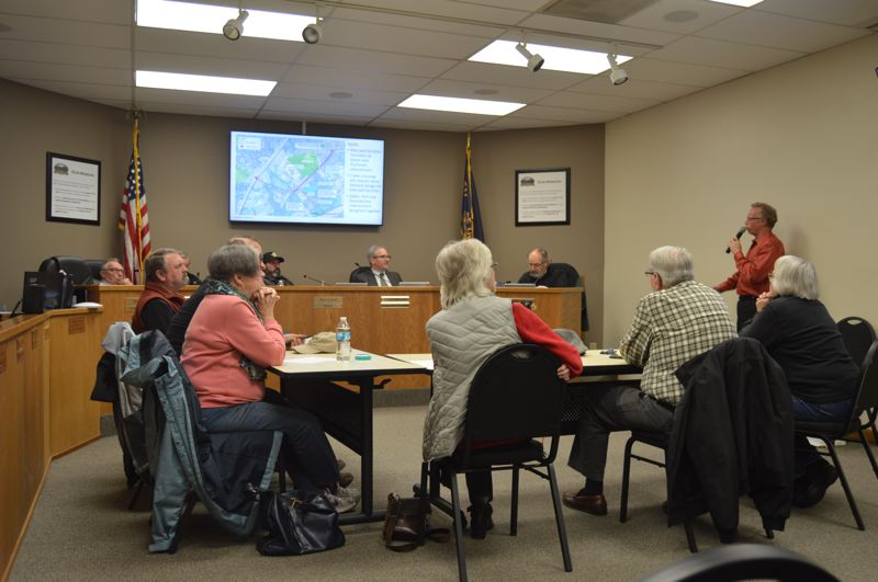 SPOTLIGHT PHOTO: NICOLE THILL-PACHECO - Matt Hastie, a project manager with Angelo Planning Group, right, speaks with the St. Helens City Council and Planning Commission about preferred design options for key intersections during a special meeting on Wednesday, Feb. 20.