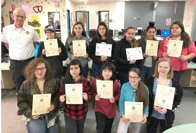 SUBMITTED PHOTO - Participants in this year's VFW Patriot's Pen contest from Jefferson County Middle School received certificates from VFW member Rich Lohman, back left. Students receiving certificates included, back row, from left, Kaitlyn Martin, Savanah Richardson, Cecilia Gonzalez, Sandra Herbert, Jasmine Perez-Rueter, and Dulce Orozco. Front row, left to right, included Syrayah Bilbruck, Yasmin Gil Cortez, Grace Fang, Hannah Pope, and Zoey Ledvina. Not pictured were Celeste Reynoso and Jaimee Ellis. Sandra Herbert and Cecilia Gonzalez were this year's winners.