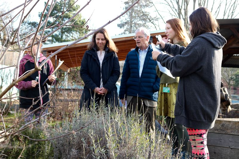 TRIBUNE PHOTO: ZANE SPARLING - Earl Blumenauer tours Sabin Elementary School's nature playground with four-grade guides Makenna, far left, and educator Ellen Berglund, center right.