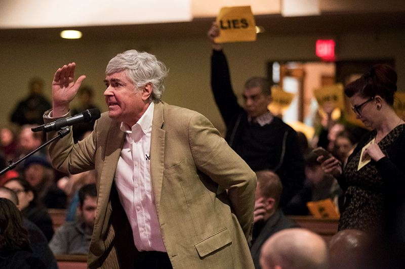 TRIBUNE PHOTO: JAIME VALDEZ - At a city listening session James Buchal critized left-leaning protesters, while defending policies of President Donadl Trump. In the background other attendees help up signs saying 'Lies.'
