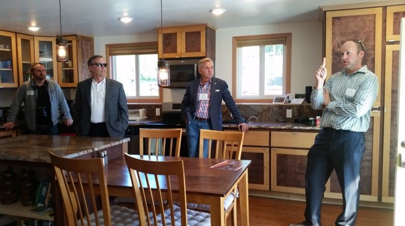 COURTESY OF KOL PETERSON  - Kol Peterson explains how ceiling heights affect the ability to convert a basement to an accessory dwelling unit, during a 2018 tour by municipal officials visiting Portland to learn about ADUs that was sponsored by Portland State Universitys Institute for Sustainable Solutions.