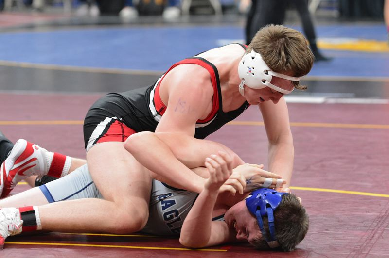 PMG PHOTO: DAVID BALL - Corbett rookie Robert Plympton works out of the top position during his 10-4 first-round win over Garret Sandefur out of Stayton.