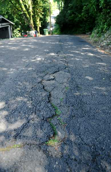 REVIEW FILE PHOTO - Clackamas County is responsible for 1,400 miles of roads, but it's the only county in the Portland metropolitan area that does not have a local source of street funding.