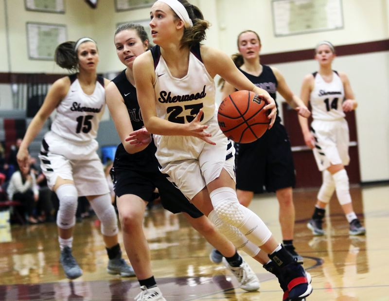 PMG PHOTO: DAN BROOD - Sherwood sophomore Joley Sproul looks to drive to the hoop during the Lady Bowmen's win over Glencoe on Thursday.