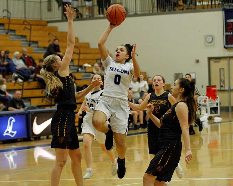 PMG PHOTO: WADE EVANSON - Liberty's Taylin Smith goes up for a shot during the Falcons' game against Forest Grove, Thursday, Feb. 21, at Liberty High School.