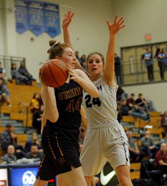 PMG PHOTO: WADE EVANSON - Olivia Grosse fights-off Liberty's Clara Robbins during the Vikings' game against the Falcons, Thursday, Feb. 21, at Liberty High School.
