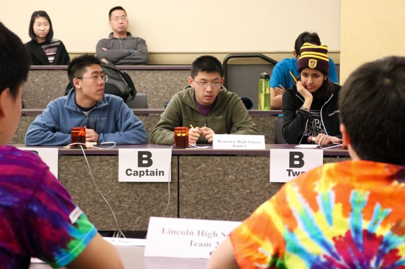 TRIBUNE PHOTO: ZANE SPARLING - Grant Chen, center, and Medha Prakash, right, of Westview High School in Beaverton compete against a team from Lincoln High School during the Regional Science Bowl on Saturday, Feb. 23.