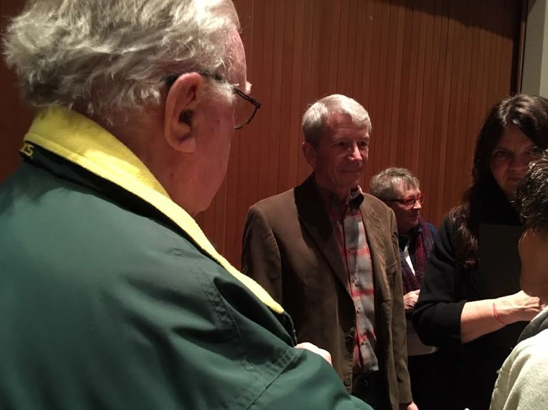 PMG PHOTO: PETER WONG - U.S. Rep. Kurt Schrader, D-Ore., center, after a town hall meeting Saturday, Feb. 23, at Milwaukie High School. At left is Roger Martin, a lobbyist and former Republican state representative; to Schrader's right is Suzanne Kunse, his district director.
