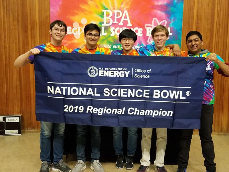 SUBMITTED PHOTO - FROM LEFT: Catlin Gabel seniors Tyler Nguyen, Avi Gupta, Mathus Leungpathomaram and juniors Will Leonard and Arjun Jain pose for a photo after winning first place at the Regional Science Bowl on Feb. 23.
