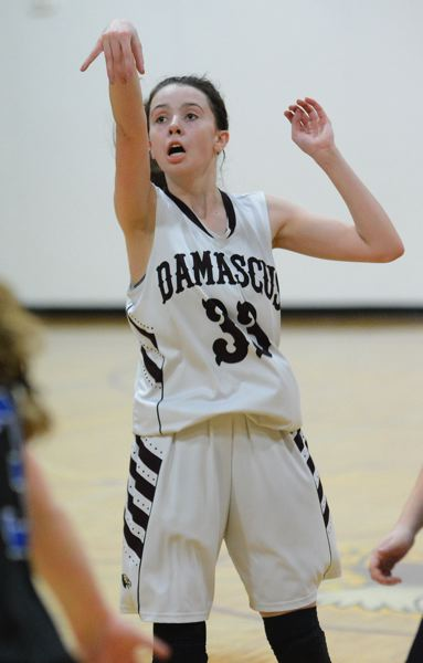 PMG PHOTO: DAVID BALL - Damascus Christians Emily Powers scored six fourth-quarter points to help the Eagles to a 36-25 playoff win at North Douglas on Saturday.
