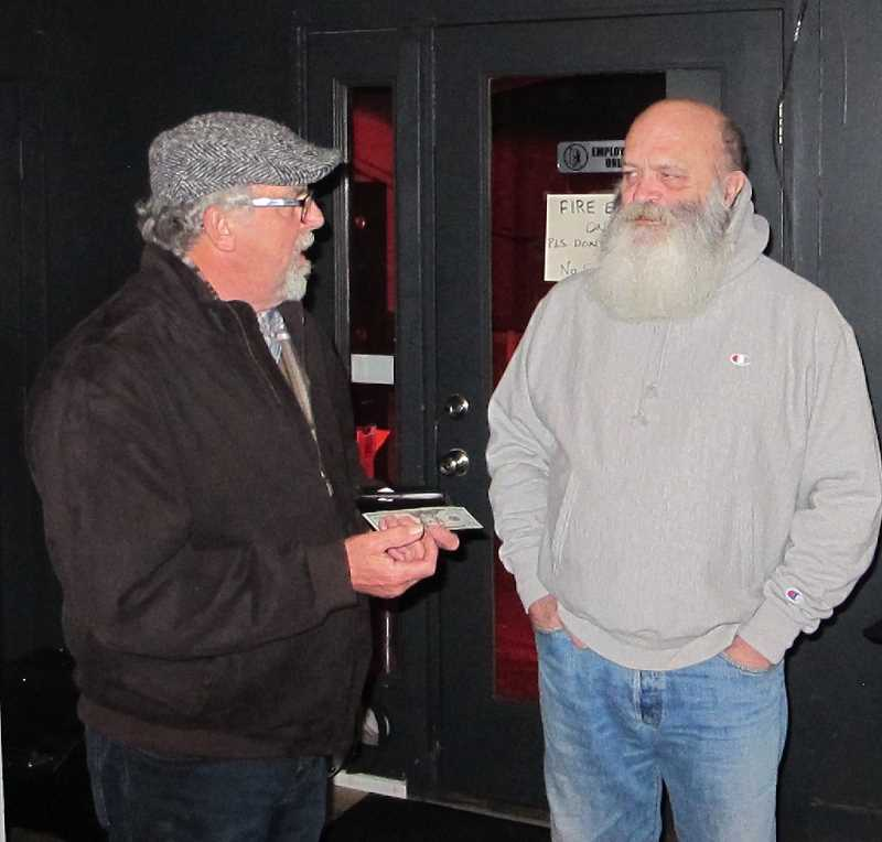 PMG PHOTO: BILL GALLAGHER - Pat Connell, left, of the bluegrass group Whistlin' Rufus, discussed the music business with Kevin Johnson at Gastromania Vault on a recent Wednesday night.