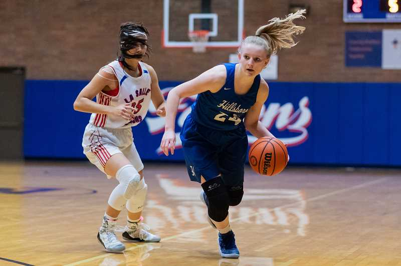 PMG PHOTO: CHRISTOPHER OERTELL - Hillsboro's Kylie Fernstrom dribbles a round a La Salle defender during the Spartans' game against the Falcons Friday, Feb. 22, at La Salle Prep.