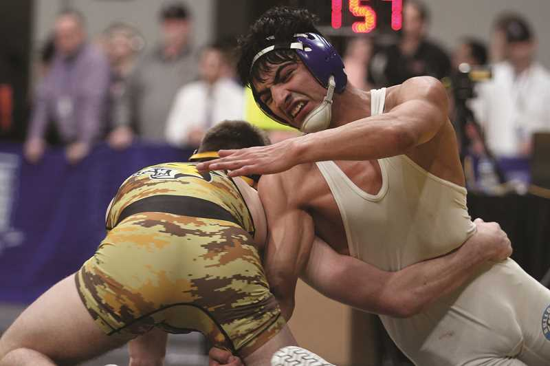 PHIL HAWKINS - Woodburn's Giovanni Bravo scored eight points in the final minute against Cascade's Kane Nixon to claim the 4A 138-pound state title on Saturday.