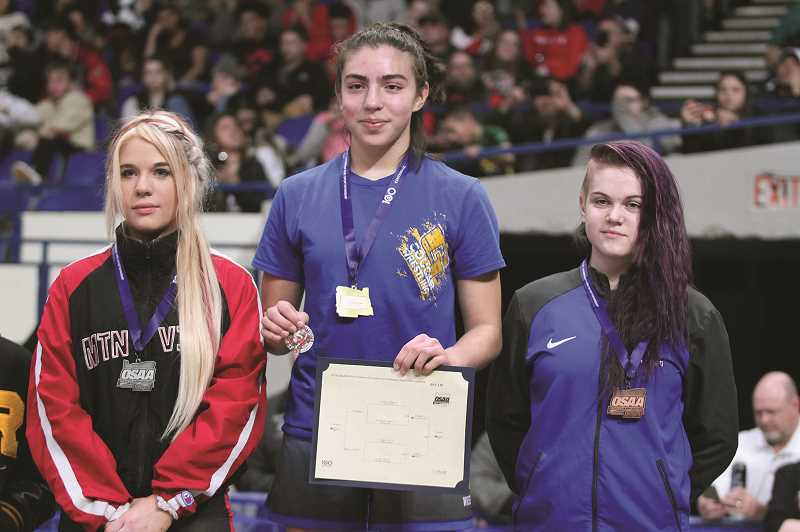 PHIL HAWKINS - Gervais sophomore Alexys Zepeda (middle) won the 2019 130-pound girls state title on Saturday with an 8-3 decision over Mountain View's Taylor Ohlson (left).
