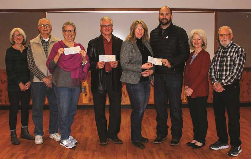 HOLLY SCHOLZ - The Crook County Cultural Coalition awarded four grants to local organizations last Thursday morning. Pictured left to right, board member Marlee Dutli, board member Lawrence Weberg, Prineville Music Theater Camp representative Barbara Punch, CCCC Chairman and Crook County Foundation board member Tom Jay, Crook County Middle School Librarian Kris Jones, CCMS Principal Kurt Sloper, board member Claudia Callan and board member Lyle Andrews.