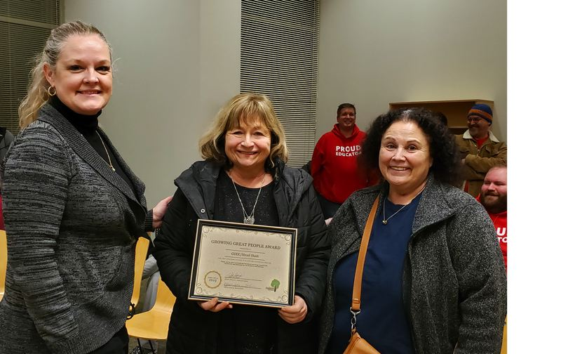 PHOTO COURTESY: LESLIE ROBINETTE - School Board Chair Kristin Eaton presented the Growing Great People Award to Sue Elder and Debbie Stedman of Head Start.