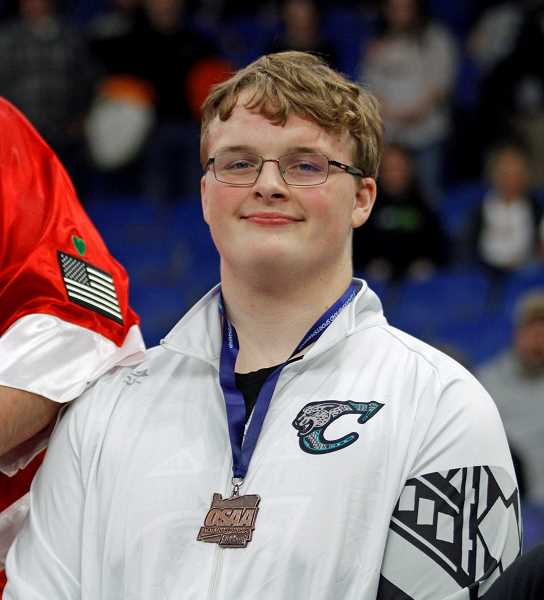 PMG PHOTO: WADE EVANSON - Century's Brody Reese poses with his third place medal at last weekend's state wrestling championships, Saturday, Feb. 23, at the Memorial Coliseum.