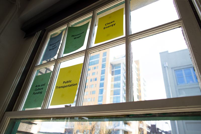 PMG PHOTO: JAIME VALDEZ - Word cloud: Dozens of windows at DHM Researchs office across the street from Wieden + Kennedy are tagged with key words from the companys mission.