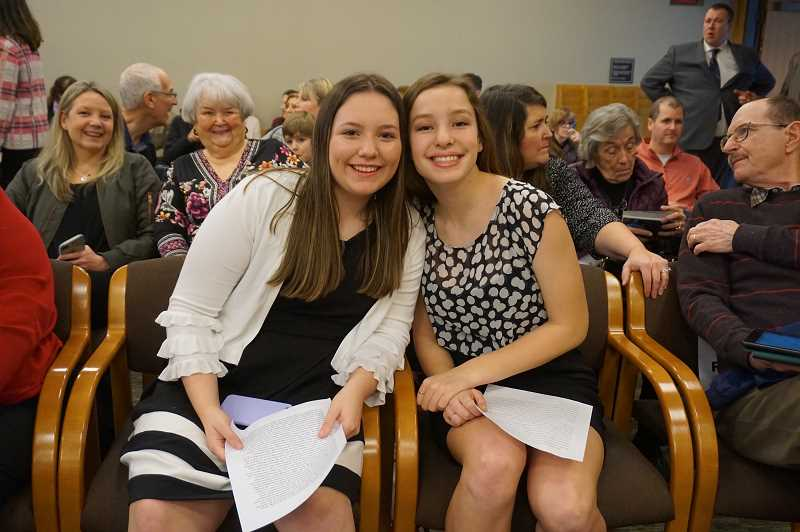 REVIEW PHOTO: CLAIRE HOLLEY - Claire Sarnowski (left) and Chanelle Buck, freshmen at Lakeridge High School, prepare to testify in front of the Senate Committee on Education.