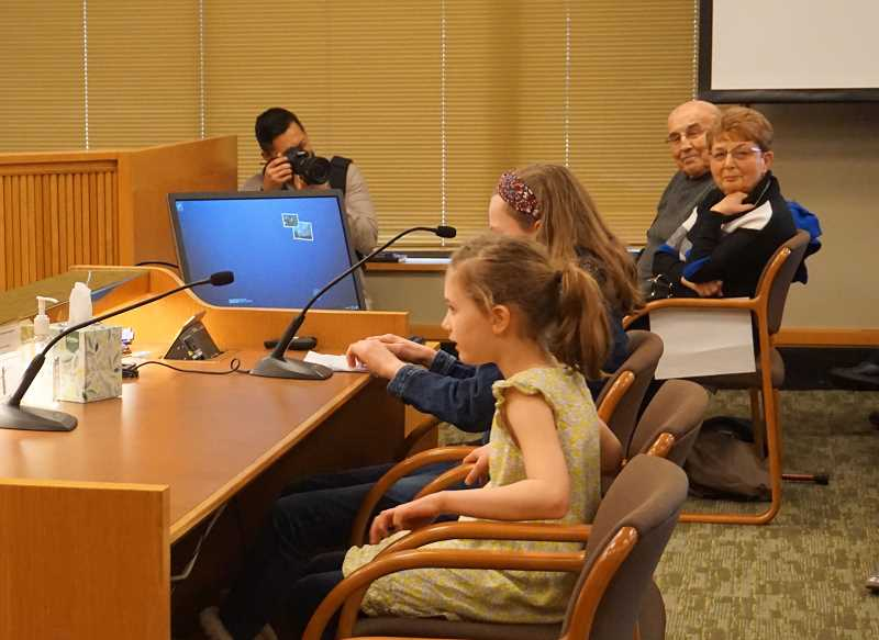 REVIEW PHOTO: CLAIRE HOLLEY - Seven-year-old Libby West and her sister Gabby, 10, testify in favor of Senate Bill 664.