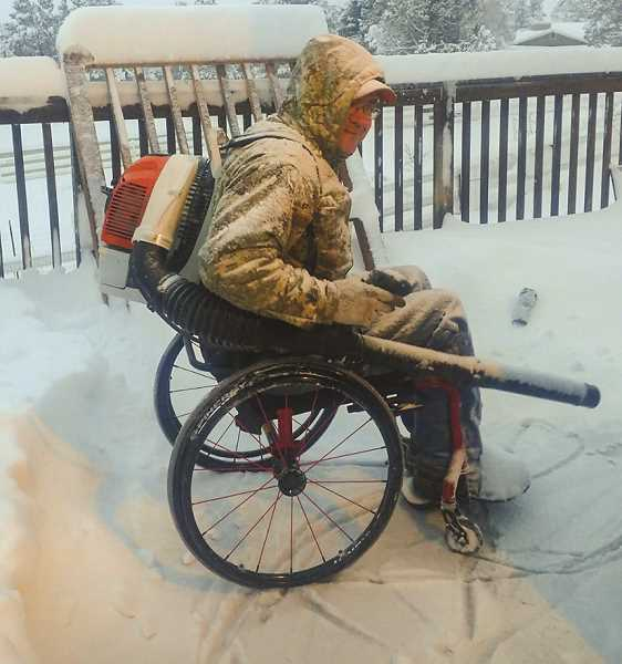 PHOTO COURTESY OF MELISSA CASE  - Kelly Case shows how he is working smarter, not harder, to remove the snow from his deck.