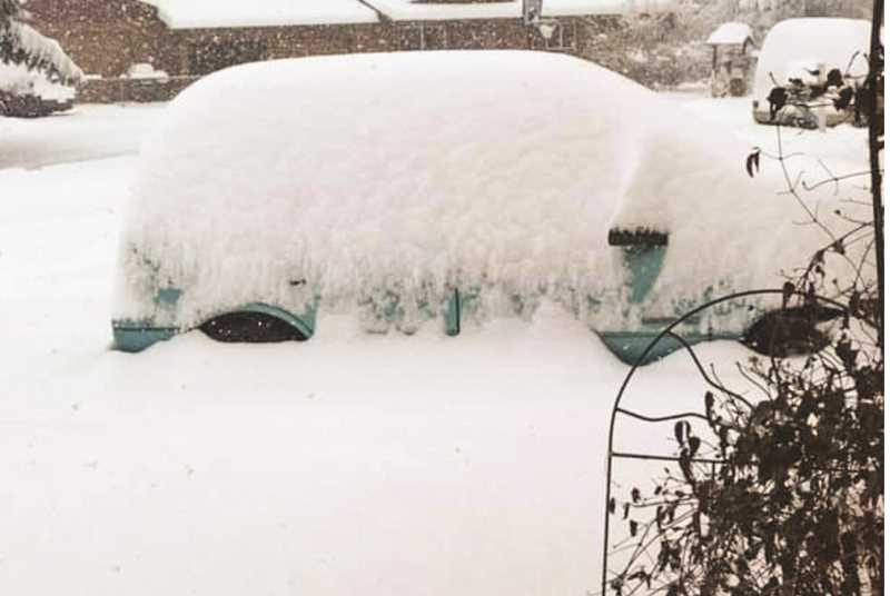 PHOTO SUBMITTED BY KATHLEEN GODAT - A car slowly disappears at a local residence as the snow piles up.