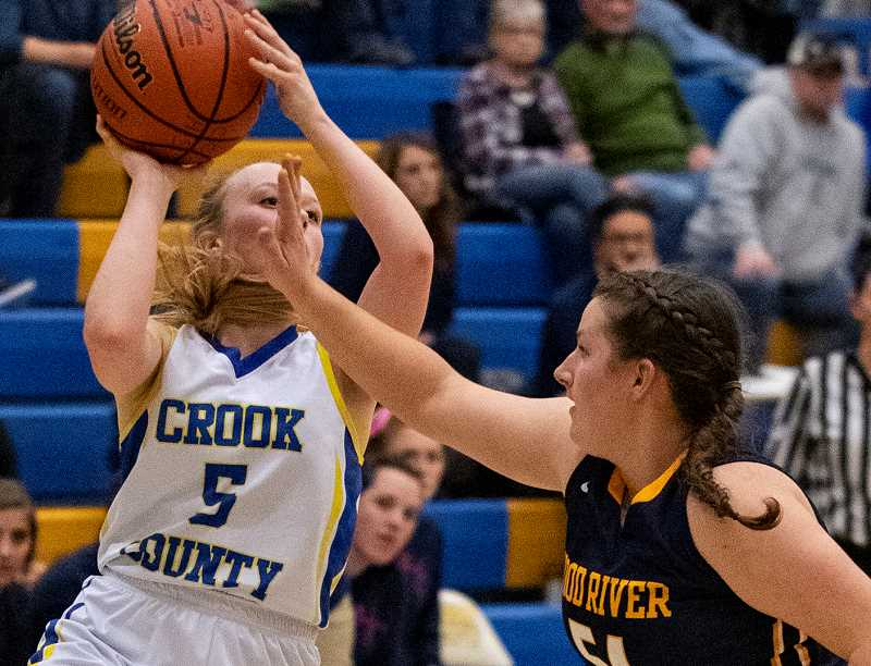 LON AUSTIN/CENTRAL OREGONIAN - Teagan Freeman goes up for a shot in a game earlier this year. Freeman led both teams in scoring on Thursday night with 16. Freeman hit four three-point shots in the game. Despite her 16 points, the Cowgirls still lost the game 54-37.