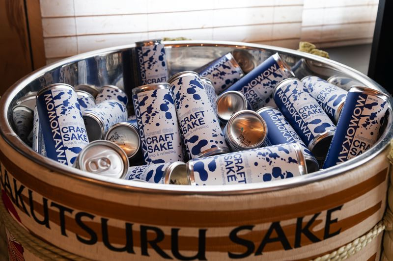 STAFF PHOTO: CHRISTOPHER OERTELL - Momokawa junmai ginjo sake now comes in single-serving aluminum cans.