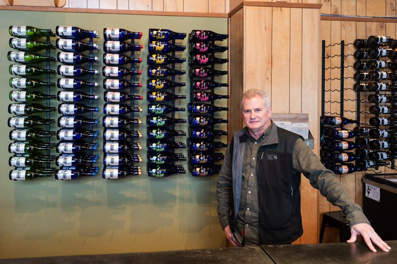 STAFF PHOTO: CHRISTOPHER OERTELL - Steve Vuylsteke stands behind the counter of SakeOne's tasting room in south Forest Grove. SakeOne is the only company in Oregon that produces craft sake.