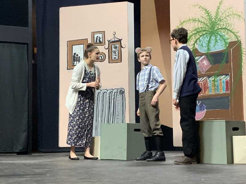 STAFF PHOTO: JANAE EASLON - Lucas Bledsoe (center) plays Stuart Little, Aliya Lamb plays Mrs. Little and Jesse Uffelman plays Mr. Little in Theatre in the Grove's all youth cast of 'Stuart Little,' opening March 1.
