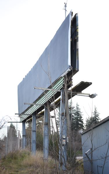 STAFF PHOTO: MATT DEBOW  - Fairviews current municipal code doesnt allow the owner to replace this aging billboard. , Gresham Outlook - News Councilors divided between 1997 vision and current path for the  Fairview community.   Fairview council debates merits of replacing three billboards