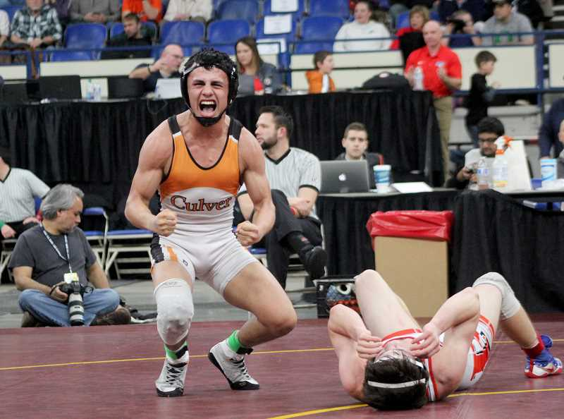 STEELE HAUGEN - Lorenzo Vasquez (126) pins his finals opponent to become a four-time state champion for Culver.