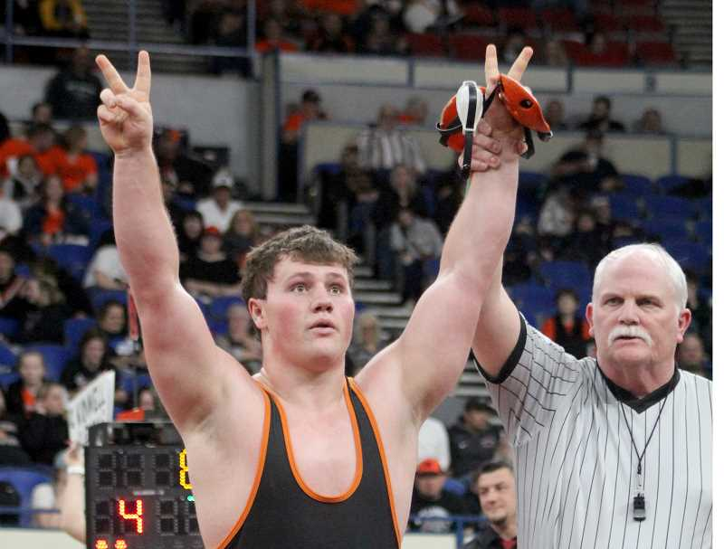 STEELE HAUGEN - Cylus Hoke throws up two fingers to show he is now a two-time state champion. The Culver wrestling team took first with 136 points, almost doubling second place Glide (71).