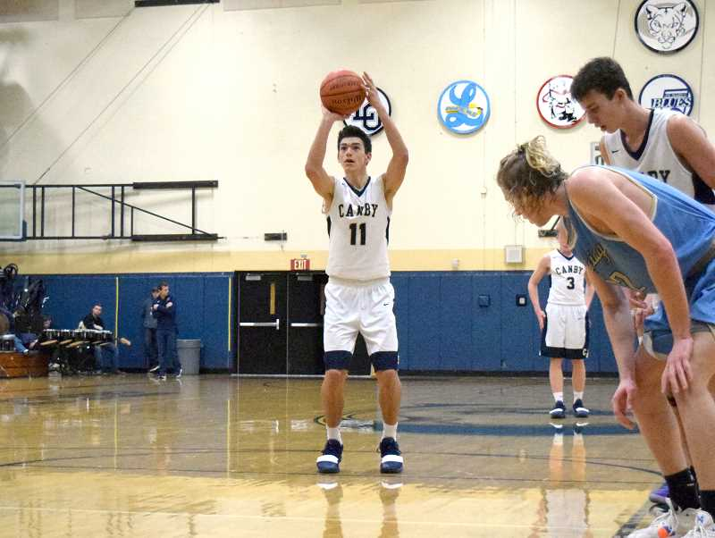 PMG PHOTO: TANNER RUSS - Canby senior Rizdin Miller was a highly productive member of the Cougars squad during the 2018-19 season.