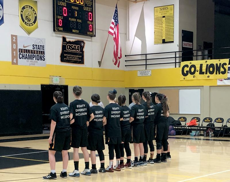 COURTESY PHOTO - Milwaukie High School basketball players wear Parkrose Strong T-shirts during the national anthem.