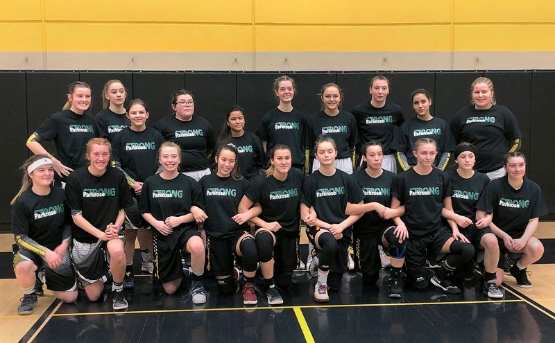 COURTESY PHOTO - Milwaukie High School basketball players lend some of their Parkrose Strong T-shirts to the St. Helens team to wear during warm-ups.