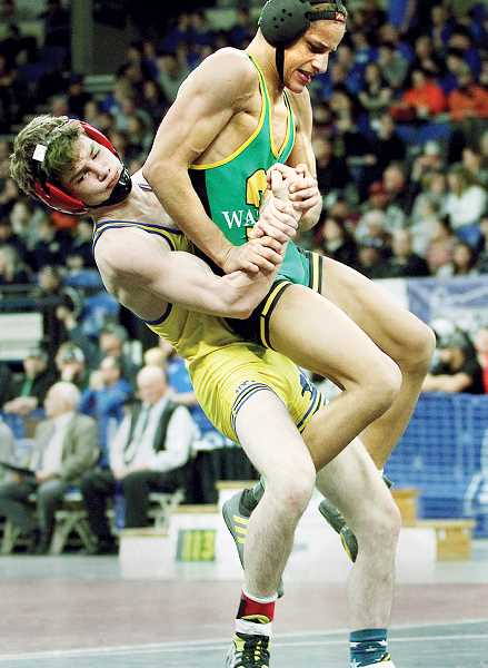 MILES VANCE -- PMG PHOTO - Senior Christopher Strange lost his bout to Cleveland's Jontae Hardaway, but his career in Newberg includes plenty of accolades.
