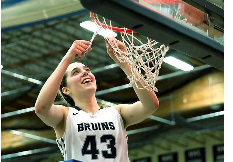 PHOTO COURTESY OF GFU - GFU junior Emily Holder cuts down the nets after her team won its 13th consecutive Northwest Conference title on Saturday.