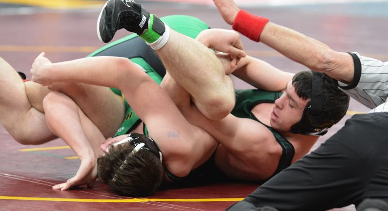 PMG PHOTO: DAVID BALL - Estacadas Lance Moser gets a count from the referee after turning Sweet Homes Austin Olin on his way to a pin in his first round match Friday.