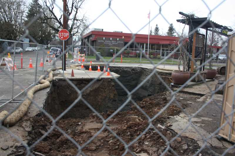 PMG PHOTO: JUSTIN MUCH - City of Woodburn was apprised that its fuel tank removal at the for Centro Gas & Market will require the removal of an additional 600 tons of contaminated soil.