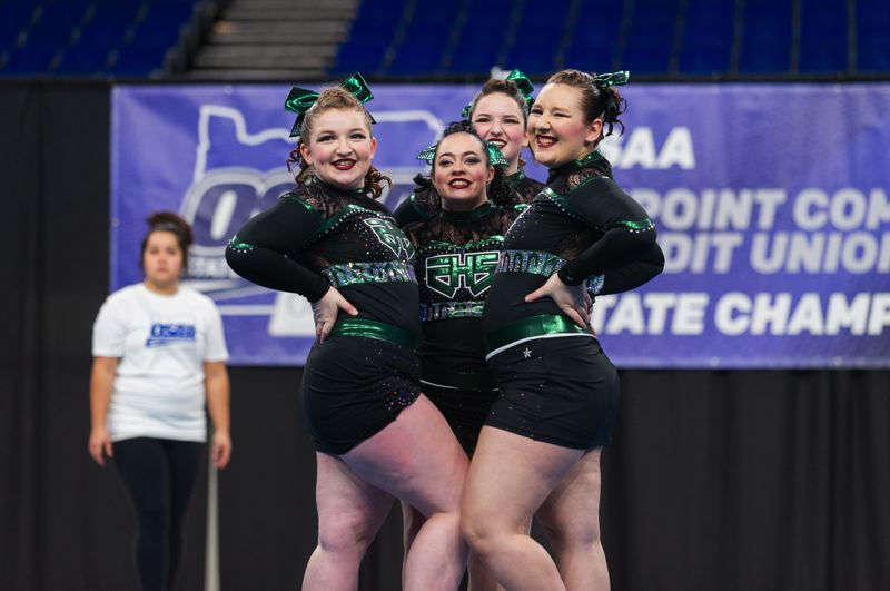 PAMPLIN MEDIA: JON HOUSE - The Estacada cheer team performs its routine at the state championships earlier this month at Memorial Coliseum. The Rangers finished with a 125.3 total score, getting its most points in the tumbling and jumps portion of the competition. Estacada finished eighth out of 10 teams.